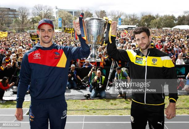 Taylor Walker of the Crows and Trent Cotchin of the Tigers pose for a photograph with the Premiership Cup during the 2017 AFL Grand Final Parade...