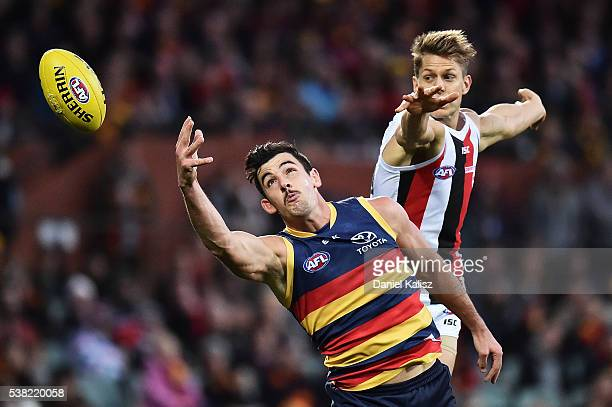 Taylor Walker of the Crows attempts to mark the ball during the round 11 AFL match between the Adelaide Crows and the St Kilda Saints at Adelaide...