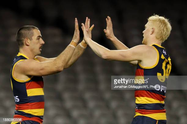 Taylor Walker of the Crows celebrates a goal during the round 20 AFL match between Adelaide Crows and Hawthorn Hawks at Marvel Stadium on July 24,...