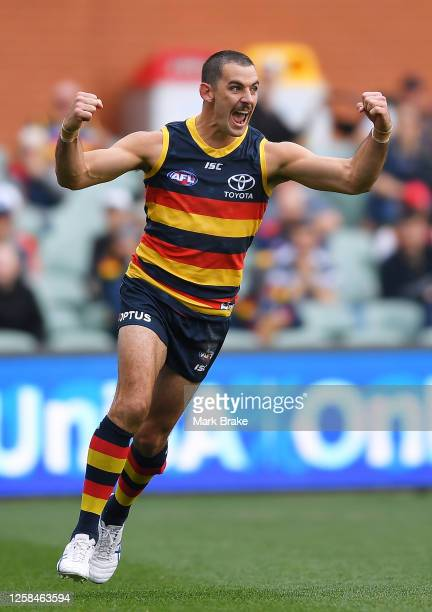 Taylor Walker of the Crows celebrates a goal during the round 8 AFL match between the Adelaide Crows and the Essendon Bombers at the Adelaide Oval on...