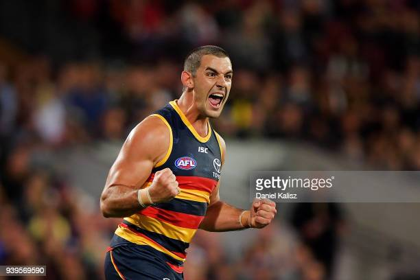 Taylor Walker of the Crows celebrates after kicking a goal during the round two AFL match between the Adelaide Crows and the Richmond Tigers at...