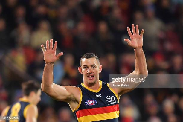 Taylor Walker of the Crows celebrates after kicking a goal during the round 15 AFL match between the Adelaide Crows and the West Coast Eagles at...