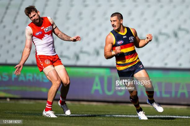 Taylor Walker of the Crows celebrates during the round 1 AFL match between the Adelaide Crows and the Sydney Swans at Adelaide Oval on March 21, 2020...