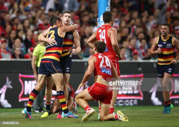 Taylor Walker of the Crows celebrates kicking a goal with team mates during the round five AFL match between the Sydney Swans and the Adelaide Crows...