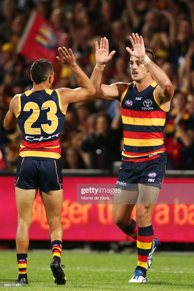 Taylor Walker of the Crows celebrates with Charlie Cameron of the Crows after Walker kicked a goal during the round four AFL match between the Adelaide Crows and the Essendon Bombers at Adelaide Oval on April 15, 2017 in Adelaide, Australia.