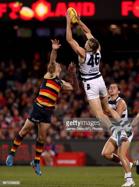 Taylor Walker of the Crows cis outworked by Mark Blicavs of the Cats during the 2018 AFL round 17 match between the Adelaide Crows and the Geelong...