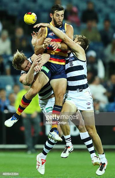 Taylor Walker of the Crows competes for the ball against against Dawson Simpson of the Cats and Jared Rivers during the NAB Challenge AFL match...