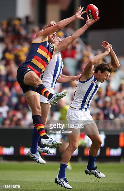 Taylor Walker of the Crows competes for the ball over Joel Tippett of the Kangaroos during the round one AFL match between the Adelaide Crows and the...
