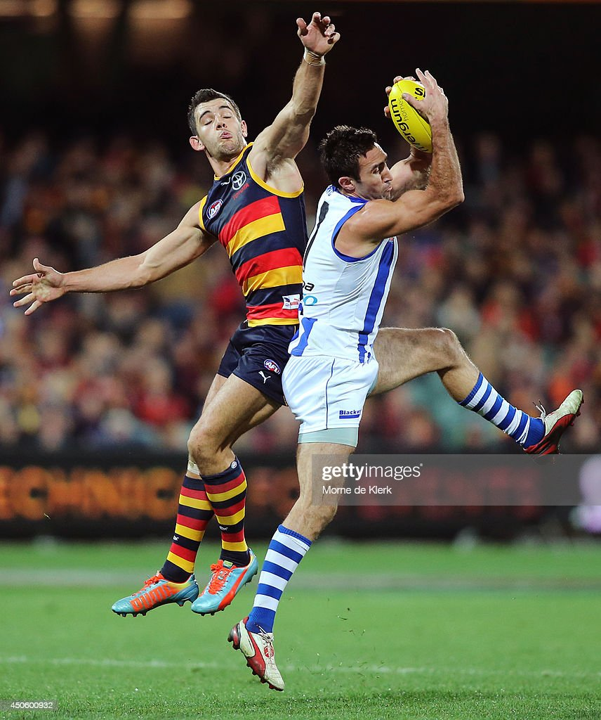 Taylor Walker of the Crows competes for the ball with Michael Firrito of the Kangaroos during the round 13 AFL match between the Adelaide Crows and the North Melbourne Kangaroos at Adelaide Oval on June 14, 2014 in Adelaide, Australia.