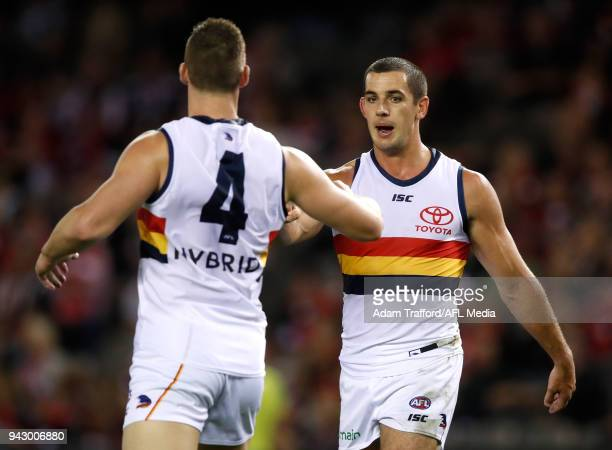 Taylor Walker of the Crows congratulates Josh Jenkins of the Crows on a goal during the 2018 AFL round 03 match between the St Kilda Saints and the...