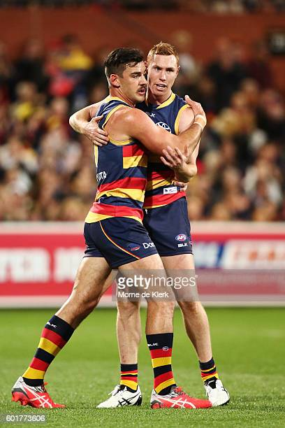 Taylor Walker of the Crows congratulates teammate Tom Lynch after Lynch kicked a goal during the AFL 1st Elimination Final match between the Adelaide...