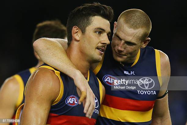 Taylor Walker of the Crows is hugged by Sam Jacobs at half time during the round one AFL match between the North Melbourne Kangaroos and the Adelaide...