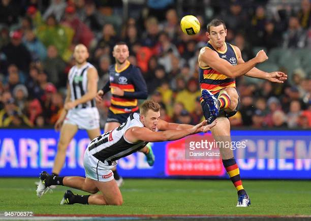 Taylor Walker of the Crows kicks the ball during the round four AFL match between the Adelaide Crows and the Collingwood Magpies at Adelaide Oval on...
