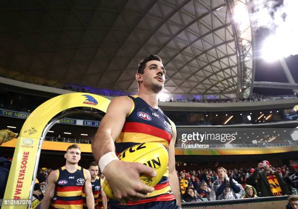 Taylor Walker of the Crows leads his team onto the ground during the round 16 AFL match between the Adelaide Crows and the Western Bulldogs at...