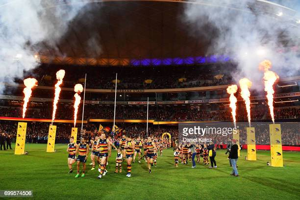 Taylor Walker of the Crows leads his team out onto the ground prior to the round 14 AFL match between the Adelaide Crows and the Hawthorn Hawks at...
