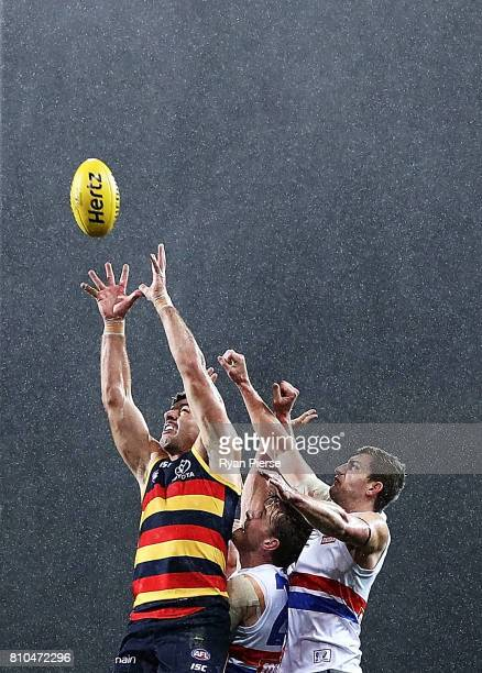 Taylor Walker of the Crows marks over Fletcher Roberts of the Bulldogs during the round 16 AFL match between the Adelaide Crows and the Western...