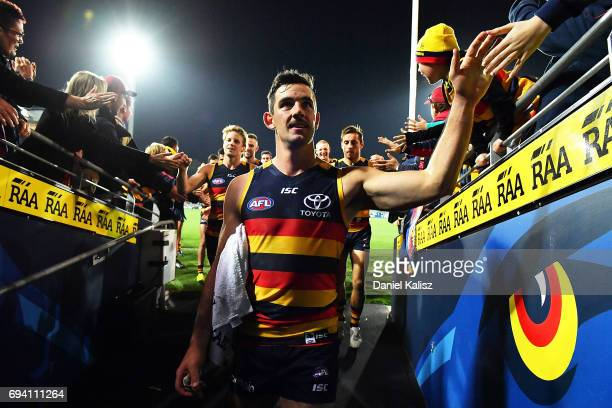 Taylor Walker of the Crows walks from the ground after the round 12 AFL match between the Adelaide Crows and the St Kilda Saints at Adelaide Oval on...
