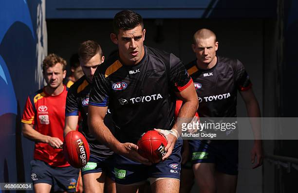 Taylor Walker of the Crows walks out for the warm up during the round one AFL match between the Adelaide Crows and the North Melbourne Kangaroos at...