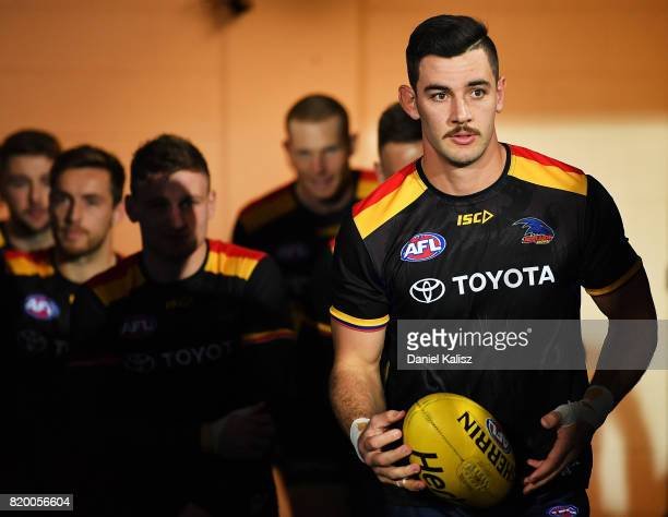 Taylor Walker of the Crows walks out onto the ground prior to the round 18 AFL match between the Adelaide Crows and the Geelong Cats at Adelaide Oval...