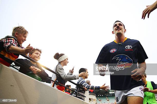 Taylor Walker of the Crows walks past after the warm up during the round 10 AFL match between the Carlton Blues and the Adelaide Crows at Melbourne...