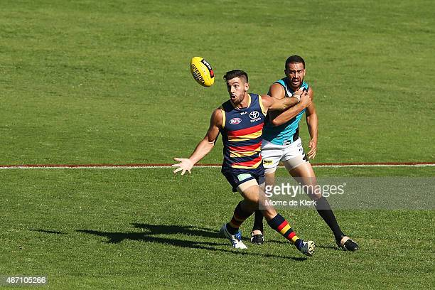 Taylor Walker of the Crows wins the ball in front of Alipate Carlile of the the Power during the NAB Challenge AFL match between the Port Adelaide...
