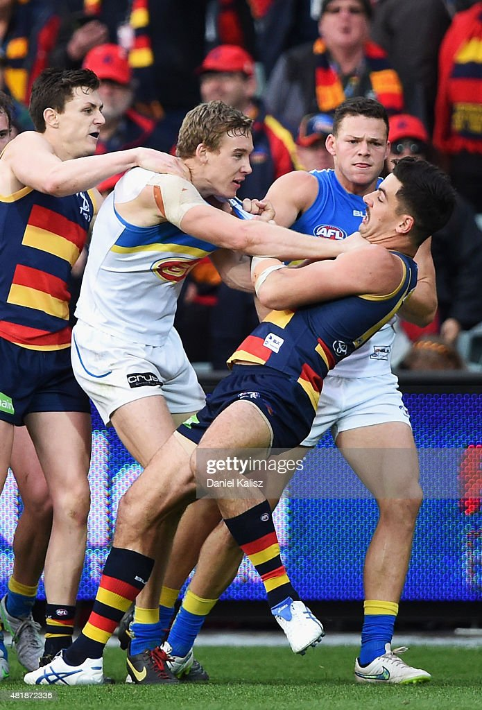 Taylor Walker of the Crows wrestles with Tom Lynch of the Suns during the round 17 AFL match between the Adelaide Crows and the GOld COast Titans at Adelaide Oval on July 25, 2015 in Adelaide, Australia.