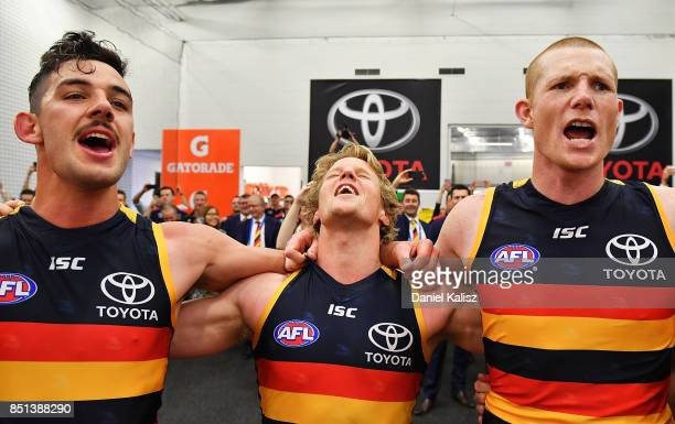 Taylor Walker Rory Sloane and Sam Jacobs of the Crows sing the club song after the First AFL Preliminary Final match between the Adelaide Crows and...
