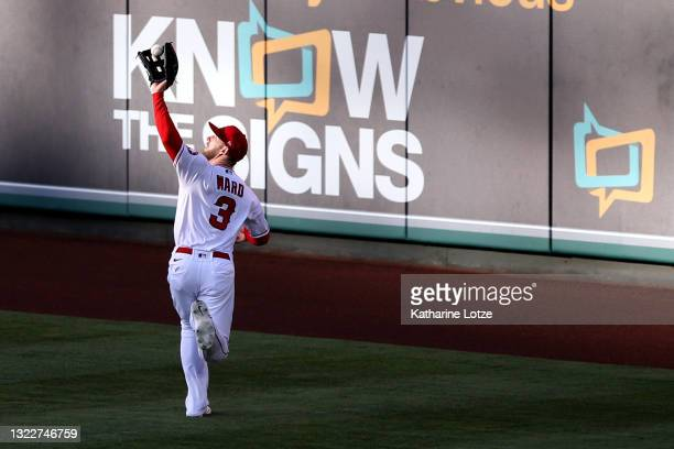 Taylor Ward of the Los Angeles Angels catches a fly ball in the outfield during the first inning against the Kansas City Royals at Angel Stadium of...