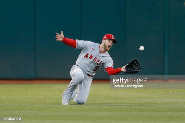 Taylor Ward of the Los Angeles Angels makes a sliding catch to get the out of Matt Chapman of the Oakland Athletics in the bottom of the fourth...