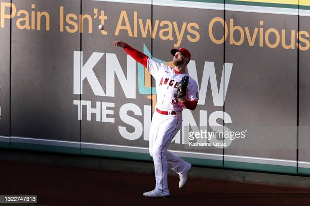 Taylor Ward of the Los Angeles Angels throws the ball from the outfield during the first inning against the Kansas City Royals at Angel Stadium of...