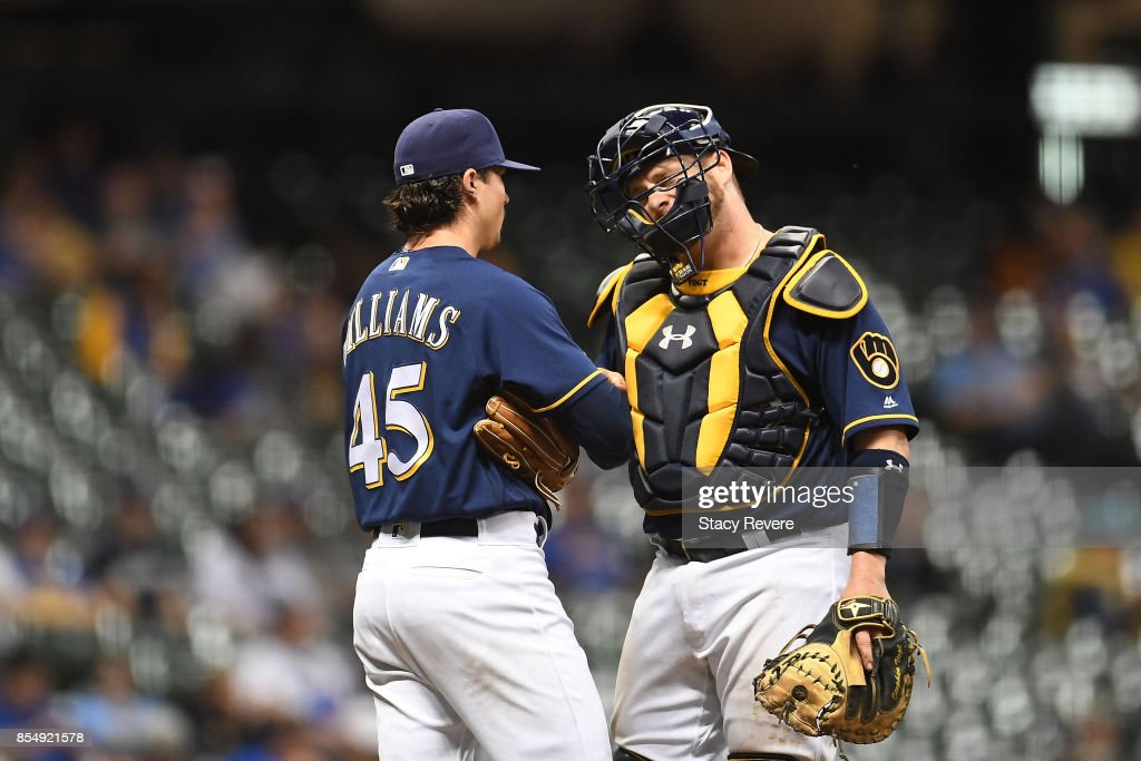 Taylor Williams #45 of the Milwaukee Brewers speaks with Stephen Vogt #12 during the ninth inning of a game against the Cincinnati Reds at Miller Park on September 27, 2017 in Milwaukee, Wisconsin.