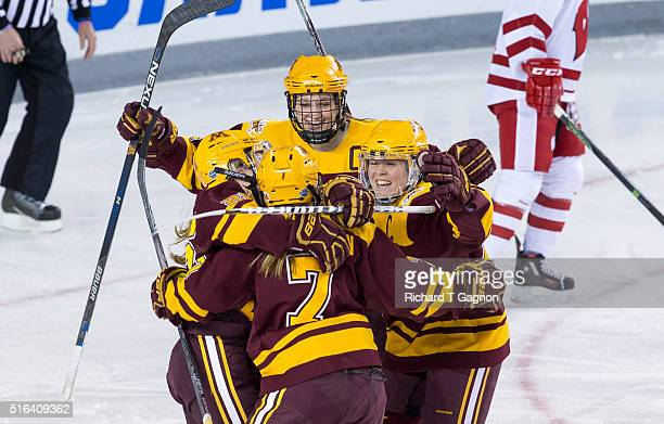 Taylor Williamson of the Minnesota Golden Gophers celebrates her goal against of the Wisconsin Badgers with teammates Lee Stecklein, Sarah Potomak,...