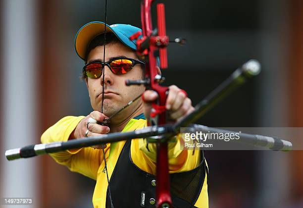 Taylor Worth of Australia competes in his Men's Individual Archery 1/8 Eliminantions match against Dai Xiaoxiang of China during the Men's Individual...