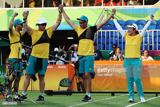 Taylor Worth Ryan Tyack and Alec Potts of Australia celebrate with Archery Australia Head Coach YaPing Shih after beating China during the Men's Team...