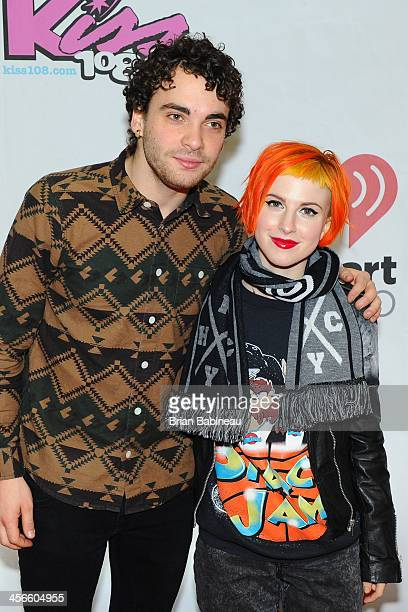 Taylor York and Hayley Williams of Paramore attends the KISS 108's Jingle Ball 2013 at the TD Garden on December 14 2013 in Boston Massachusetts