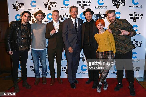 Taylor York of Paramore producer Ryan Lewis rapper Macklemore Tom Poleman musician Gavin DeGraw and Hayley Williams and Jeremy Davis of Paramore...
