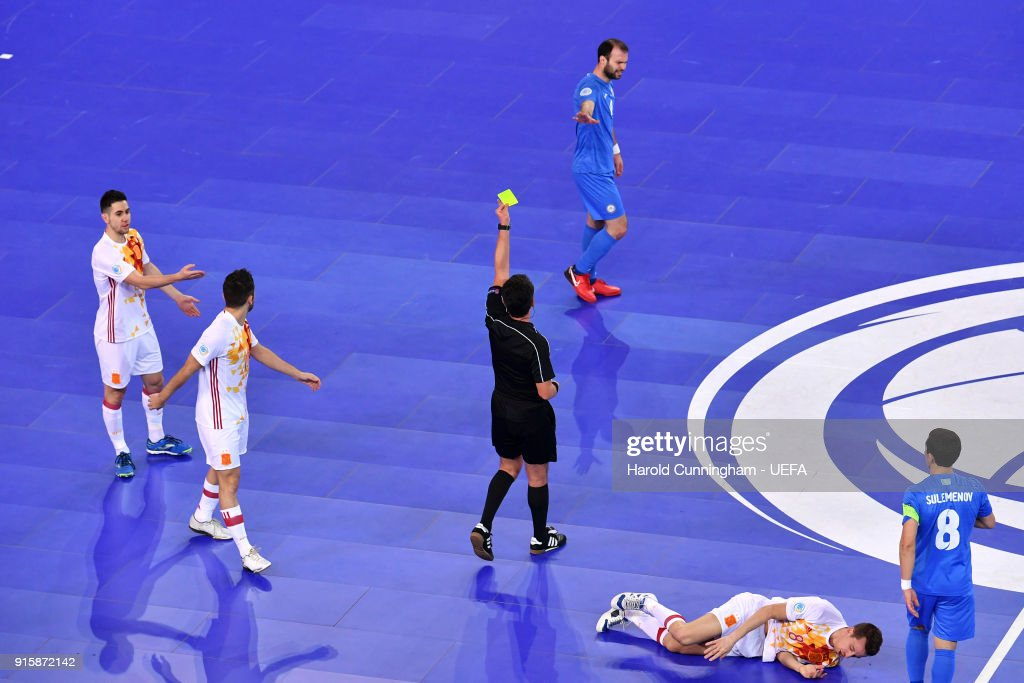 9e3f8a8f0f110 Taynan of Kazakhstan is shown a yellow card during the UEFA Futsal ...