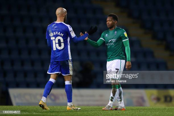 Tayo Edun of Lincoln City and Jordan Graham of Gillingham FC interact following the Sky Bet League One match between Gillingham and Lincoln City at...
