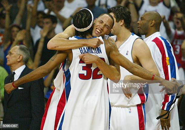 Tayshaun Price celebrates with teammate Richard Hamilton of the Detroit Pistons seconds before defeating the Los Angeles Lakers 100-87 in game five...