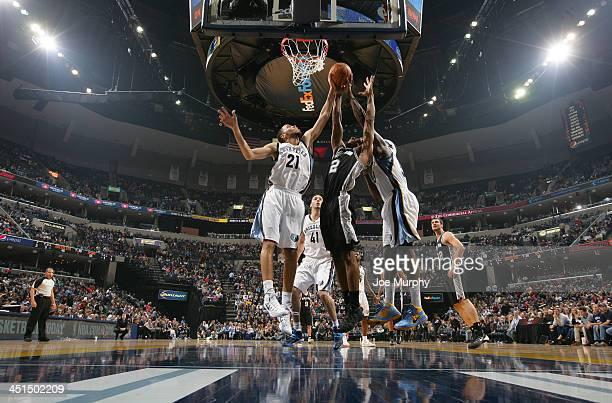 Tayshaun Prince and Zach Randolph of the Memphis Grizzlies rebound against Kawhi Leonard of the San Antonio Spurs on November 22 2013 at FedExForum...