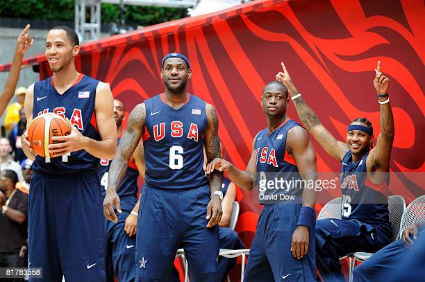 Tayshaun Prince LeBron James Dwyane Wade and Carmelo Anthony of the USA Basketball Senior Men's Team Team watch the activities during the USA...