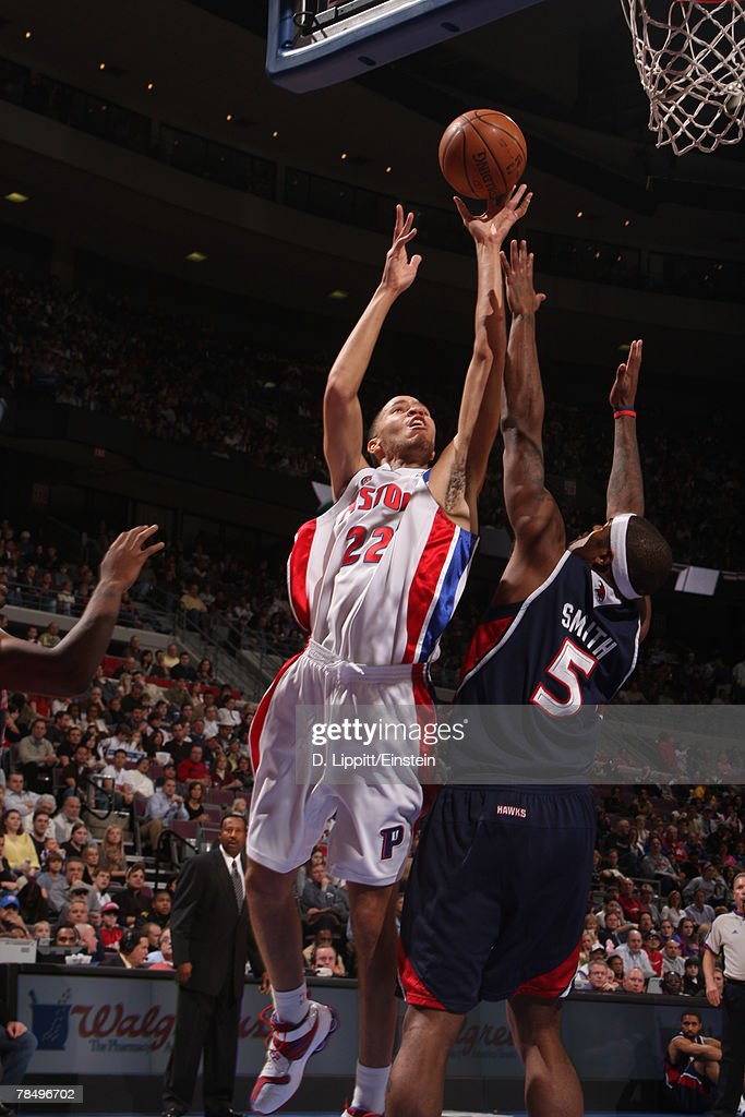 Tayshaun Prince #22 of the Detroit Pistons attempts a shot over Josh Smith #5 of the Atlanta Hawks at the Palace of Auburn Hills December 14, 2007 in Auburn Hills, Michigan.