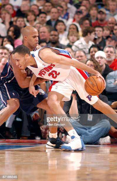 Tayshaun Prince of the Detroit Pistons battles towards the net against Richard Jefferson of the New Jersey Nets in a game on March 26, 2006 at the...