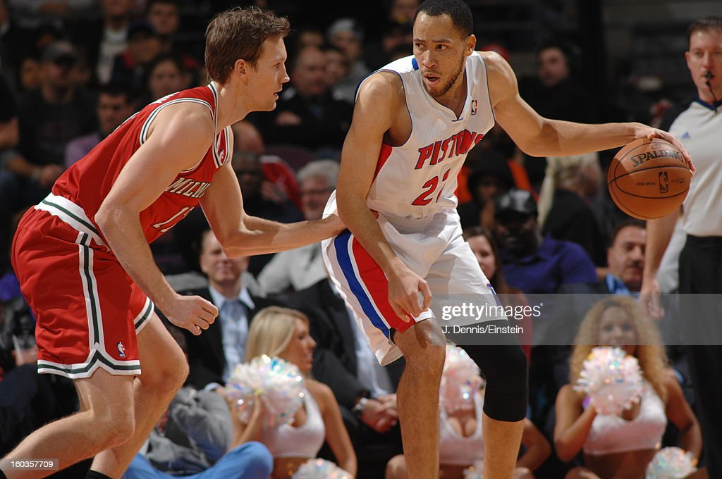 Tayshaun Prince #22 of the Detroit Pistons dribbles the ball while backing up Mike Dunleavy #17 of the Milwaukee Bucks during the game on January 29, 2013 at The Palace of Auburn Hills in Auburn Hills, Michigan.