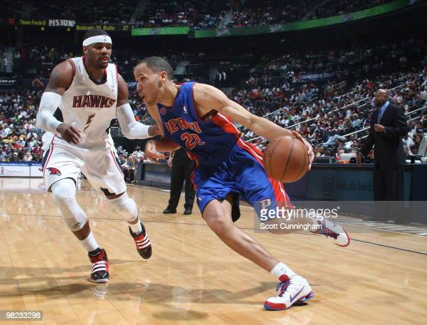 Tayshaun Prince of the Detroit Pistons drives against Josh Smith of the Atlanta Hawks on April 3 2010 at Philips Arena in Atlanta Georgia NOTE TO...