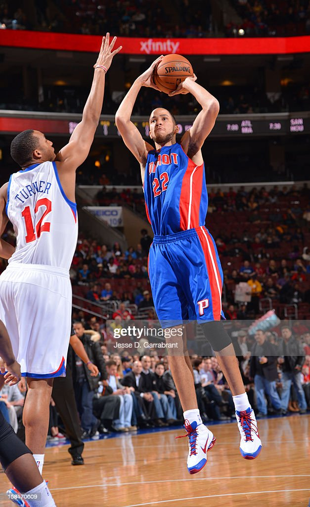 Tayshaun Prince #22 of the Detroit Pistons goes for a jump shot against Evan Turner #12 of the Philadelphia 76ers during the game between the Detroit Pistons and the Philadelphia 76ers at the Wells Fargo Center on December 10, 2012 in Philadelphia, Pennsylvania.