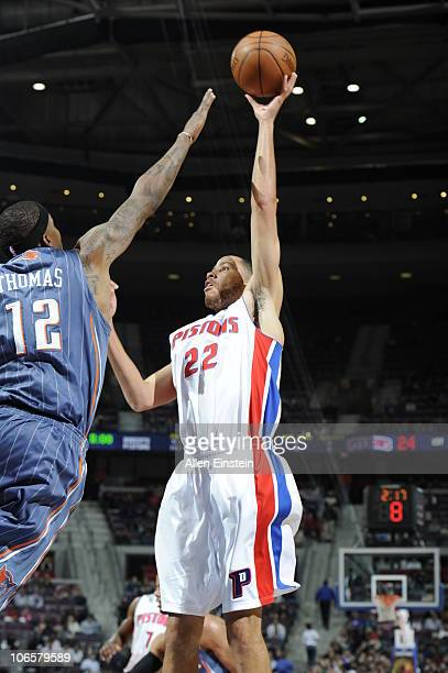 Tayshaun Prince of the Detroit Pistons goes up for a shot against Tyrus Thomas of the Charlotte Bobcats in a game on November 5 2010 at The Palace of...