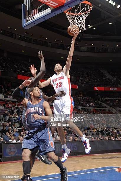 Tayshaun Prince of the Detroit Pistons goes up for a shot attempt over Tyrus Thomas and DJ Augustin of the Charlotte Bobcats in a game on November 5...