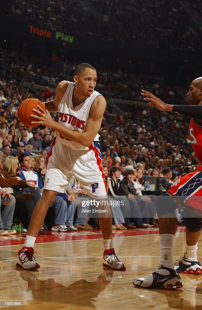 Tayshaun Prince #22 of the Detroit Pistons looks to make a move against Vince Carter #15 of the New Jersey Nets during a game at the Palace of Auburn Hills on December 26, 2006 in Auburn Hills, Michigan. The Pistons defeated the Nets 92-91.
