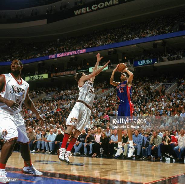 Tayshaun Prince of the Detroit Pistons shoots a jump shot against Kyle Korver of the Philadelphia 76ers in Game three of the Eastern Conference...